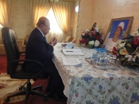Ambassador of Brunei praying for the late man after signing the book of condolence