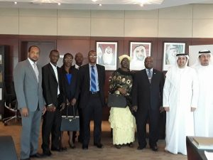 Amb.-Timbo-3rd-from-right-flanked-by-his-wife-embassy-staff-UAE-Minister-of-Economy-and-team.