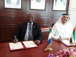 Amb.-Timbo-and-UAE-Economy-minister-smiling-after-signing-agreement.