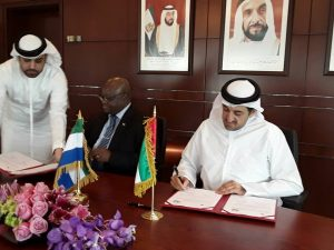 Amb.-Timbo-signing-economic coperation with UAE-Dep. Economy Minister.