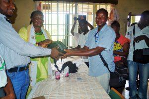 The Mayor of Kenema city, Esther G. Kaisamba presenting Cameras