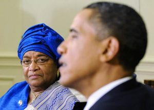 President of Liberia Ellen Johnson Sirleaf (L) listens to U.S. President Barack Obama talk as he welcomes her in the Oval Office at the White House in Washington, May 27, 2010.